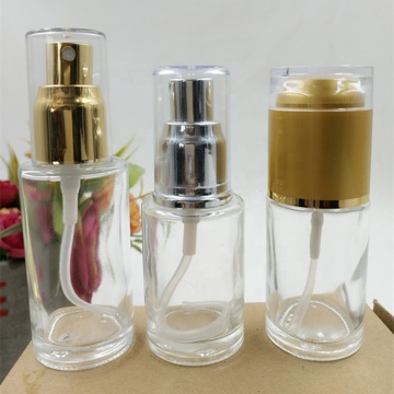 Clear glass cosmetic spray bottles with PP caps