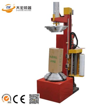 Automatic box wrapping machine