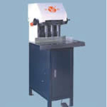 Cabinet type drilling machine