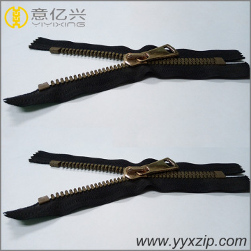 plastic zipper with brown teeth closed end