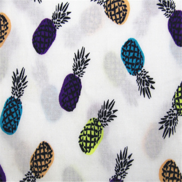 Cotton poplin with pineapple print on white background