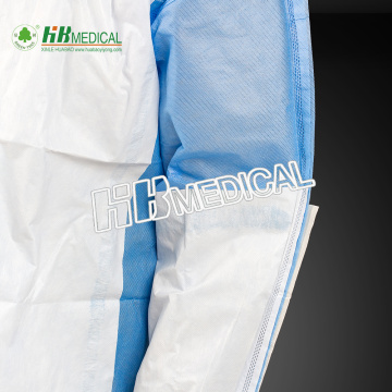 Disposable sugical gown material with reinforced piece
