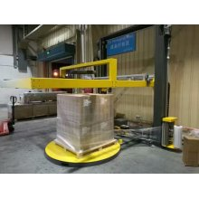 Pallet Wrapping With Top Sheet Dispenser