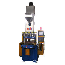 Hybrid vertical injection molding machine for PBT
