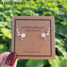 Uini-Tail hot new 925 sterling silver natural shell hand-carved flower earrings Korean plum small fresh ear jewelry GN540