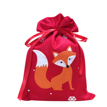 Red christmas sack with fox pattern