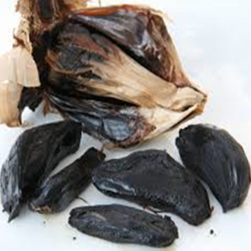 whole black garlic with sweet-and-sour