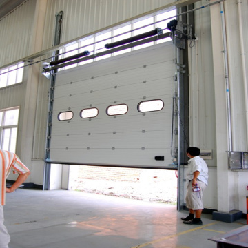 Rapid action overhead vertical sectional door for factory