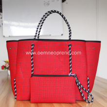 Red perforated foldable beach tote bag