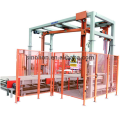 Combined automatic pallet wrapper with top sheet dispenser
