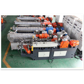 Water strand polymer compounding extruder