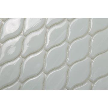 White Glass Mosaic On The Kitchen Backsplash Wall