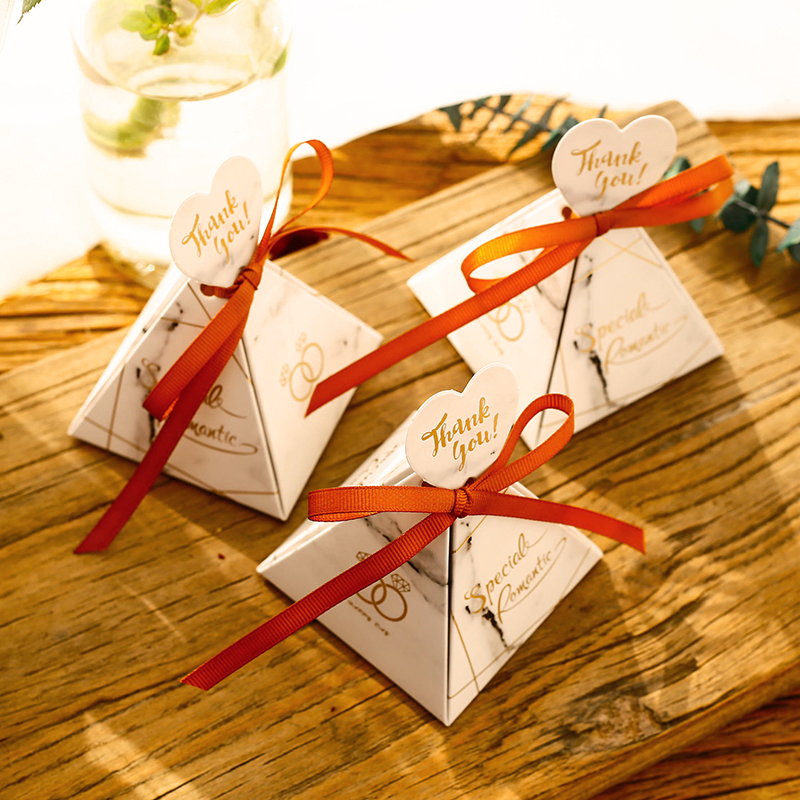 Small triangular paper candy box