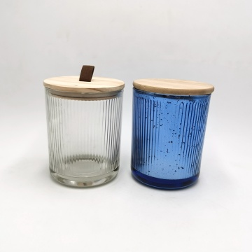 Mercury color inside ribbed glass candle jar with wood lid