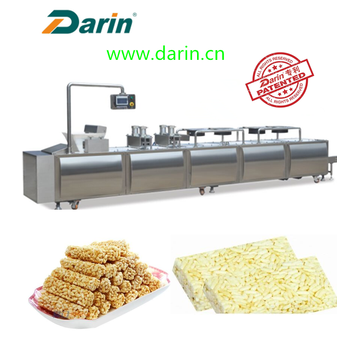 Extruded rice cereal bar compression molding machine.