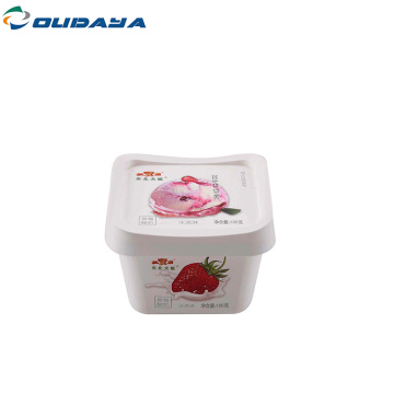 square yogurt cup with lid and spoon