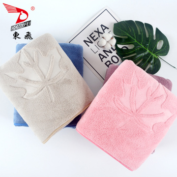 super absorbent plain embossed coral fleece bath towel