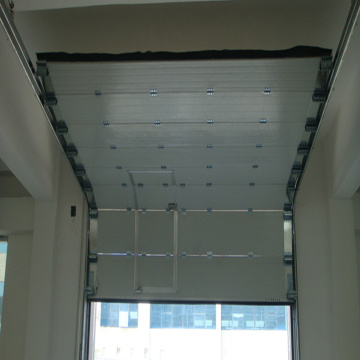 High speed rolling up overhead sectional door