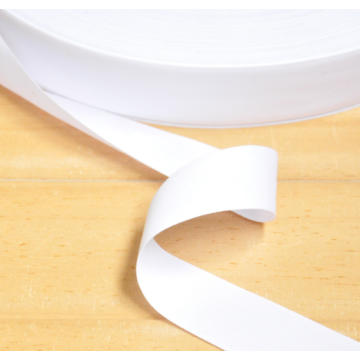 Reinforced decorative tape for pure cotton fabric
