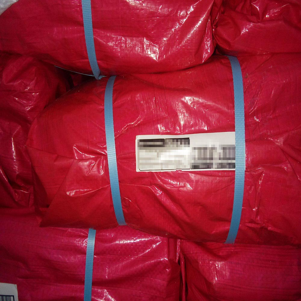 Red Tarps Packed in Bale