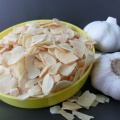 White dehydrated garlic flakes slices