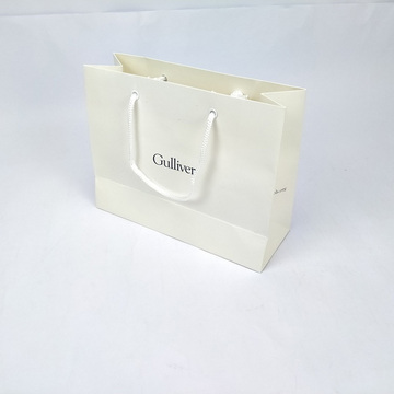 White handle paper clothes bag