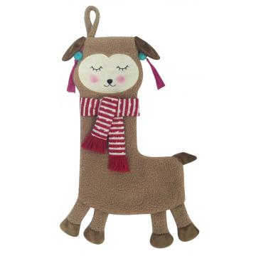 sheep with plush Christmas stocking