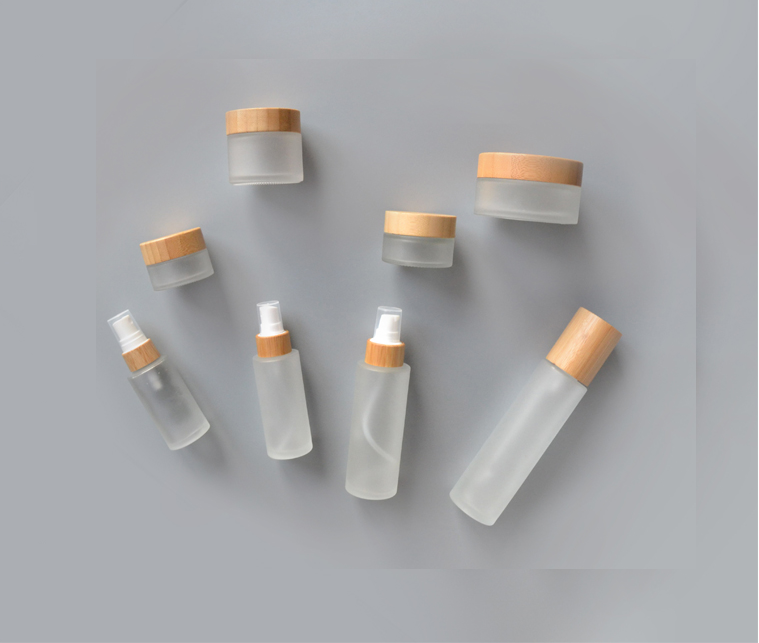 Spray frosted glass bottles with bamboo cosmetic lid
