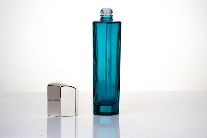 Blue glass hexagon cosmetic containers with silver cap